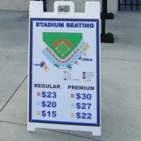 A sign outside of the Blue Jays' stadium in Dunedin lists prices by game classification